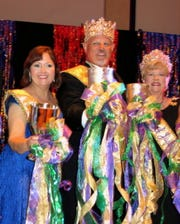 Krewe Justinian biggies: Captain XXVI Rebecca Edwards, King Jeff Cox, Queen Helen Herzog meet their subjects at Royalty Coronation.