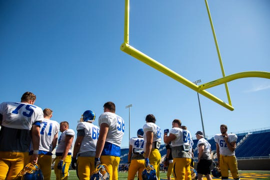 SDSU offense players wait between during practice at SDSU media day at Dana J. Dykhouse Stadium, Tuesday, Aug. 13.