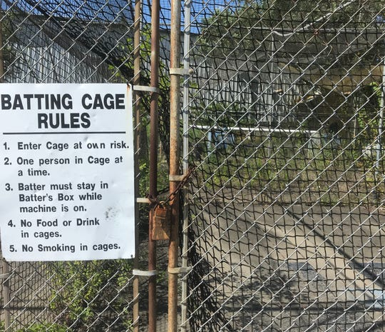 The batting cages are overgrown.