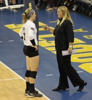 Lily Johnson and now-former head Missouri State volleyball coach Melissa Stokes talk during a game.