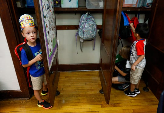 First grade student Bennett Sinn, left, tells one of his classmates that he found his spot in the locker on the first day of school at Sunshine Elementary School on Tuesday, Aug. 13, 2019, in Springfield, Mo. Bennett was celebrating his birthday on the first day of school.