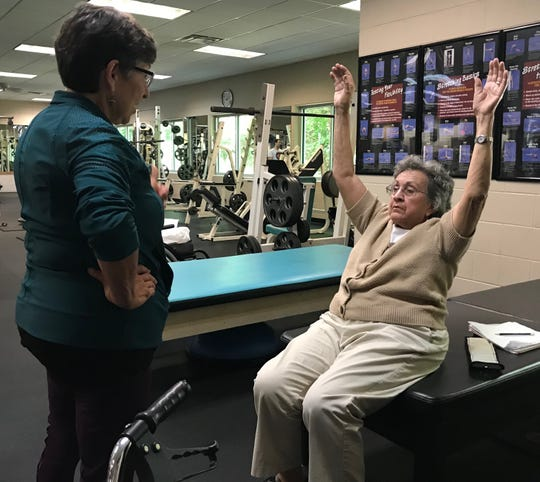 Instructor Peggy Smith works on stretching activities with Jewell Phelps, who has Parkinson's disease during a neuro-wellness class at Staunton-Augusta YMCA on Monday, Aug. 12, 2019.