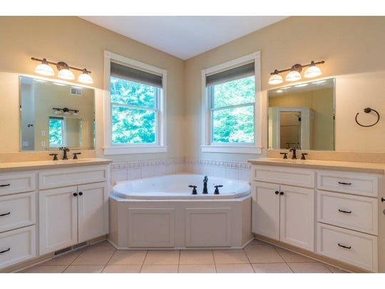 The master suite includes a master bath with a large jetted tub.