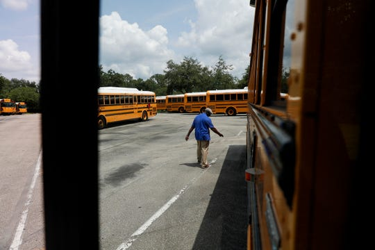 Leon County School Busses Lead Worker Greg Bruce prepares a bus for its afternoon route at the Conner-Lakes Leon County Schools Bus Compound Tuesday, August 13, 2019.