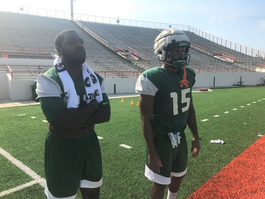 FAMU linebackers Doyle Grimes (left) and Elijah Richardson check out the action on the field during practice.
