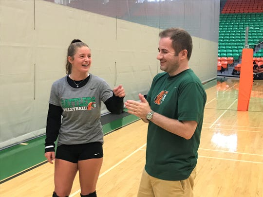 FAMU libero Jessa Long and volleyball head coach Gokhan Yilmaz were all smiles upon returning to work for the first day of practice on Monday, Aug. 12, 2019.