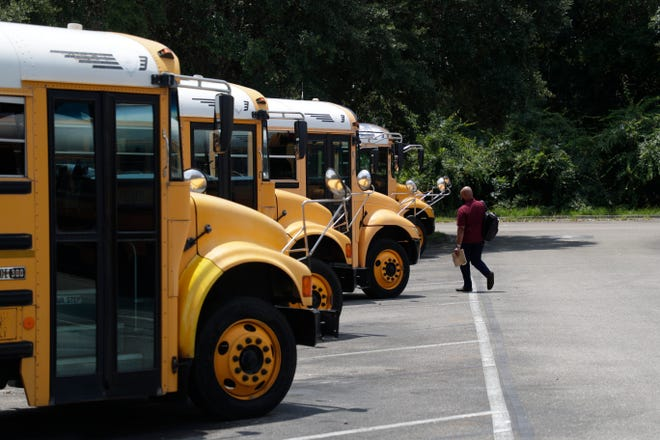 A Leon County Schools bus driver makes his way to a bus before afternoon pick-up at the Conner-Lakes Leon County Schools Bus Compound Tuesday, August 13, 2019.