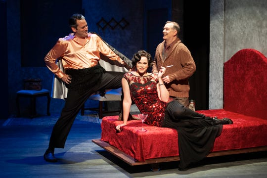 The Man in the Chair (Robert A. Stuart), right, eagerly imagines his favorite characters Adolpho (Nathan Williamson) and the Drowsy Chaperone (Melinda Melendez).