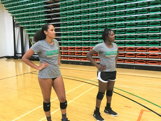 FAMU volleyball players Alexis Gosha (left) and Kalen Blathers look over action during the first day of practice on Monday, Aug. 13, 2019.
