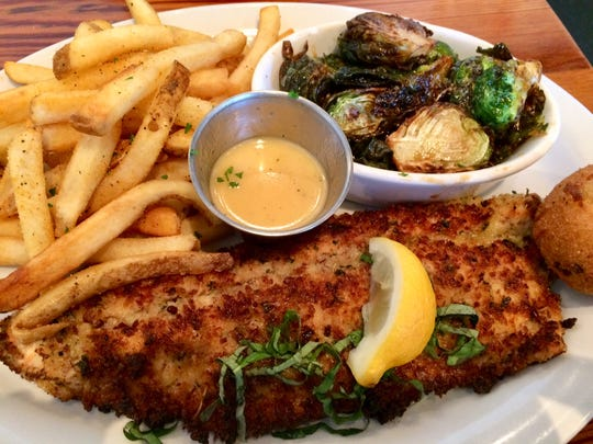 Pecan-crusted trout at Jonah's with my sides Brussels sprouts and French fries.