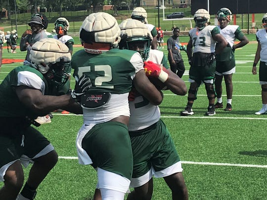 FAMU linebacker Derrick Mayweather bulldozes his way through to make a hit on a running back in practice.