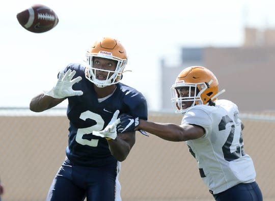 UTEP junior transfer wide receiver Devaughn Cooper looks in a pass covered by defensive back Josh Caldwell Tuesday at Glory Road Field.