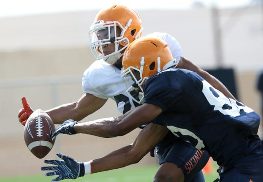 UTEP senior wide receiver Camryn Curtis Dozier has a pass slip through his hands while covered by defensive back Duron Lowe during Tuesday's practice.