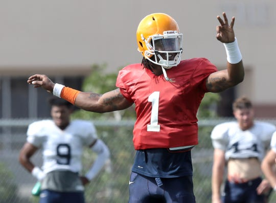UTEP quarterback Kai Locksley calls a play at the line of scrimmage during Tuesday's practice at Glory Road Field.