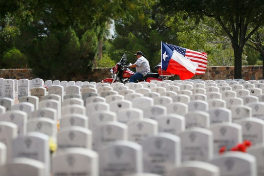 Family and friends of Arturo Benavides gather Tuesday, Aug. 13, to pay their respects at Fort Bliss National Cemetery. Benavides was a decorated U.S. Army Veteran who was killed in the El Paso Walmart shooting..