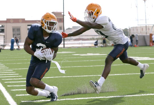 UTEP junior transfer wide receiver out of Arizona Devaughn Cooper catches a pass and keeps his feet in bounds during Tuesday's practice at Glory Road Field covered by defensive back Ray Walters.