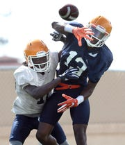 UTEP freshman wide receiver Quintavius Workman has his pass attempt broken up by junior defensive back Robert Corner III during the team's practice Tuesday at Glory Road Field.