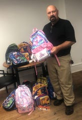 Steve DeFelice, community liaison, Hopeloft, accepts a donation of school supplies from Circle D Farm in Bridgeton on behalf of Hopeloft/Operation South Jersey.