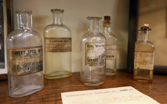 Old medicine bottles in the local history room of the Adriance Memorial Library in Poughkeepsie Aug. 13, 2019.
