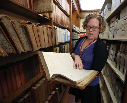 Kira Thompson, local history librarian with a collection of Common Council meeting minutes at the Adriance Memorial Library in Poughkeepsie Aug. 13, 2019.