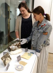 Andrea Winograd, right, Director of the Holocaust Museum and Center for Tolerance and Education, and Abigail Miller, Educational Director and Historian in Residence, discuss the pitcher from Aushwitz, an artifact that was donated by a Holocaust survivor, Aug. 13, 2019 at the museum located at Rockland Community College in Suffern. Artifacts from the survivor, including bricks and glass from the Warsaw Ghetto, where he lived, and dishes and cutlery from Aushwitz, where he survived were donated to the museum.