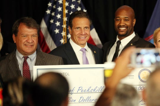 From left, Westchester County Executive George Latimer, Governor Andrew Cuomo and Peekskill Mayor Andre Rainey pose for photos after it was annouced that the city of Peekskill will be getting 10 million dollars for revitalizing the city's downtown while at the Hudson Room in Peekskill Aug. 13, 2019.