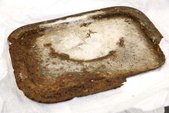 A tray from Aushwitz, which was donated by a Holocaust survivor, is seen at the Holocaust Museum and Center for Tolerance and Education, Aug. 13, 2019 at Rockland Community College in Suffern. Artifacts from a survivor, including bricks and glass from the Warsaw Ghetto, where he lived, and dishes and cutlery from Aushwitz, where he survived were donated to the museum.