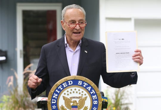 United States Sen. Chuck Schumer talks about the SALT deduction issue and Trump tax cut bill, while standing in front of a house on Carolyn Avenue in White Plains Aug. 13, 2019.