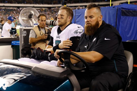 Philadelphia Eagles' Nate Sudfeld is driven off the field after an injury during the first half of the team's preseason game against the Tennessee Titans, Thursday, Aug. 8, 2019, in Philadelphia.