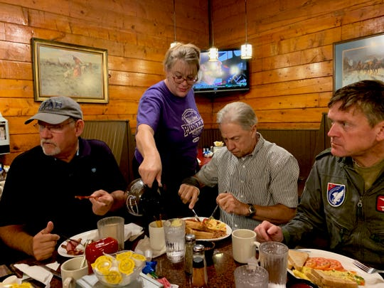 Christy Clark serves breakfast to members of the Thick Skin Breakfast Club, Jerry Morgan, Dan Campbell and Col. Werner Theisen at Pioneer of Texas on Maplewood. Clark will leave her job as a waitress to become a first-year teacher at Booker T. Washington Elementary School.