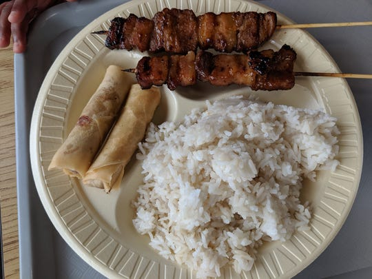 Pork belly skewers, lumpia and rice at the Philippine House Restaurant.
