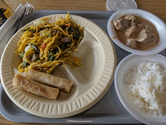 Rice noodles with vegetables, lumpia, pork adobo and rice at the Philippine House Restaurant.