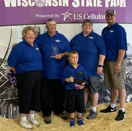 The Skalitzy family of Waterloo was honored at the Wisconsin State Fair recently for their dedication to the pork industry and showing swine. Family members include Gary and his wife Diann, their daughter Jody and her husband Kyle Joas and their son Reid.