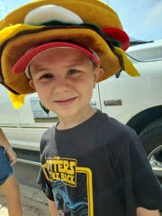 Wyatt wearing a hamburger hat.