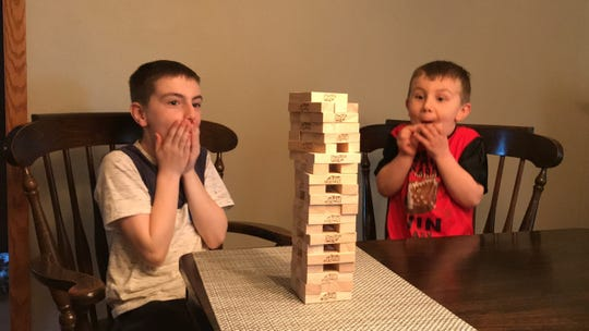 Eli and Wyatt playing a breath-taking game of Jenga.
