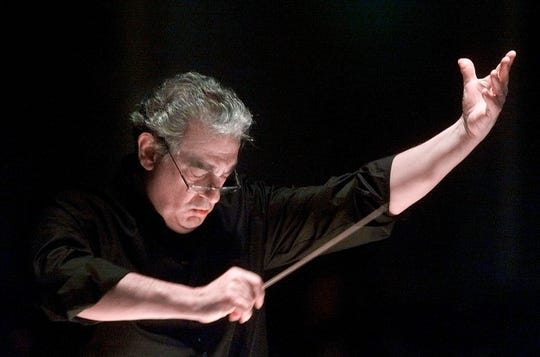 In this Jan. 27, 2001, file photo, Plácido Domingo directs the Washington Opera Orchestra and Chorus during a rehearsal of Verdi's Requiem at Washington's Constitution Hall. Nine women in the opera world have told the Associated Press that they were sexually harassed by Domingo in encounters that took place over three decades.