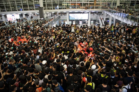 Anti-government protesters surround a man they accuse of being a mainland Chinese police officer during a sit-in against police violence in Hong Kong Chek Lap Kok International Airport, August 13 2019. EPA-EFE/Laurel Chor