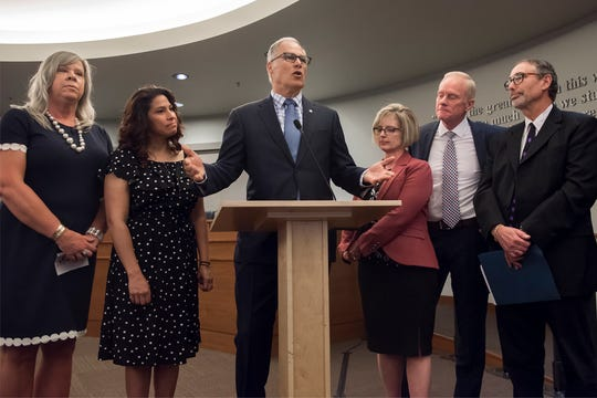 Holly Long, Evergreen School District's health services manager, from left, Rep. Monica Stonier, D-Vancouver; Washington Gov. Jay Inslee, Sen. Annette Cleveland, D-Vancouver; Rep. Paul Harris, R-Vancouver; and Dr. Alan Melnick speak before the signing of HB 1638 at Vancouver City Hall on Friday, May 10, 2019.