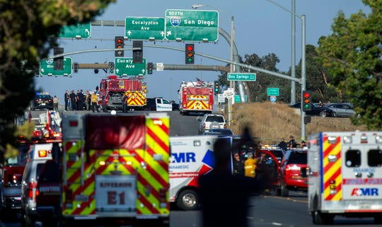 Authorities work the scene of a shootout on Monday near Interstate 215 in Riverside, Calif.