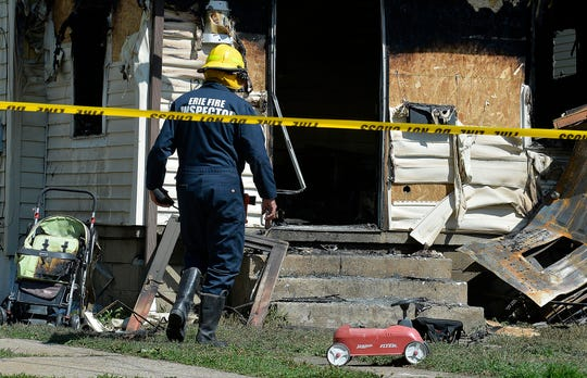 Erie Bureau of Fire Inspector Mark Polanski helps investigate a fatal fire at 1248 West 11th St. in Erie, Pa, on Sunday, Aug. 11, 2019. Authorities say an early morning fire in northwestern Pennsylvania claimed the lives of multiple children and sent another person to the hospital.