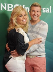 TV personalities Julie Chrisley and Todd Chrisley arrive at the 2014 Television Critics Association Summer Press Tour on July 14, 2014 in Beverly Hills, Calif.