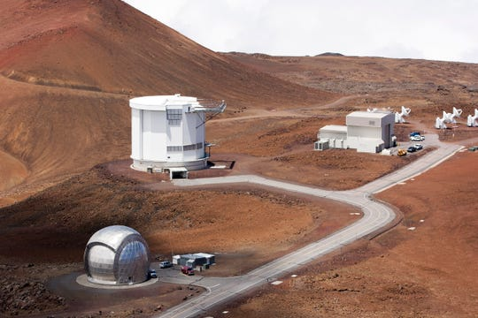 In this Aug. 31, 2015, file photo, from bottom left, the Caltech Submillimeter Observatory, the James Clerk Maxwell Telescope and the Submillimeter Array, far right, are shown on Hawaii's Mauna Kea near Hilo, Hawaii.