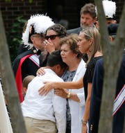 Family and friends watch as the casket of Virginia Beach shooting victim Kate Nixon is wheeled to a hearse after a funeral service at St. Gregory The Great Catholic Church in Virginia Beach , Virginia, on June 6, 2019. Nixon was killed along with 11 others during a mass shooting.