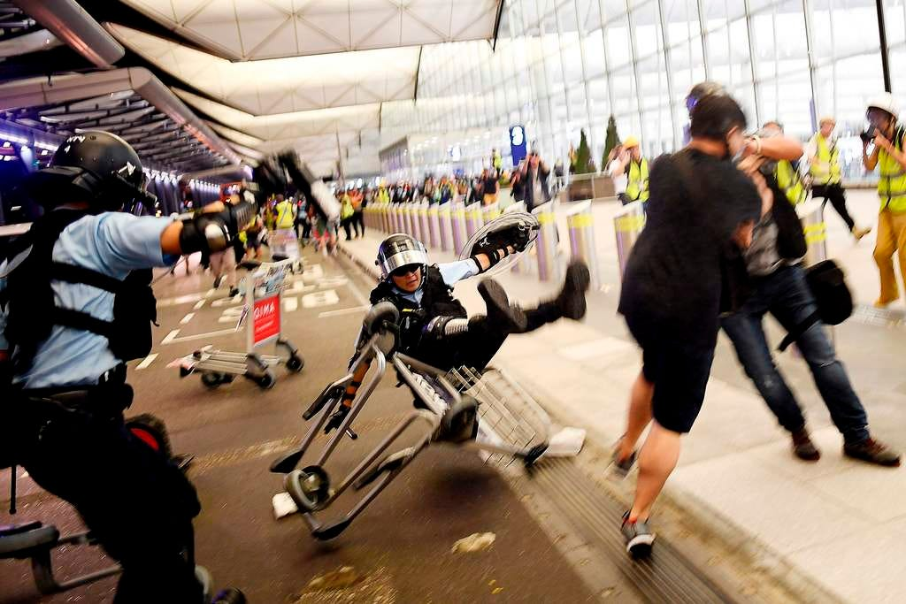 Ten dramatic images from the Hong Kong airport protests and clashes with police
