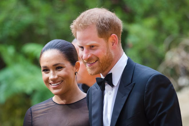 """Prince Harry and Duchess Meghan of Sussex at the premiere of """"The Lion King"""" in London on July 14, 2019."""