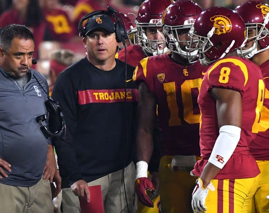 Southern California coach coach Clay Helton talks to players during his team's game against Notre Dame in 2018.