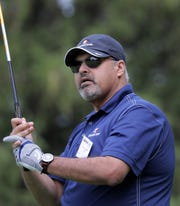 Dr. Imran Andrabi watches a drive during the U.S. Venture Open golf event Wednesday at Butte des Morts Country Club.