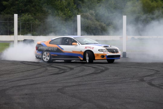 "Alex Biese, Asbury Park Press features reporter, participates in a driving experience with a stunt driver during press day for the new Netflix stunt car racing show, ""Hyperdrive,"" at Old Bridge Township Raceway Park in Englishtown, NJ Tuesday, August 6, 2019."