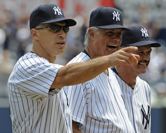 Former New York Yankees players Joe Girardi (left), Lou Piniella and Ron Guidry (right) look on during Old Timers' Day ceremonies in 2011.