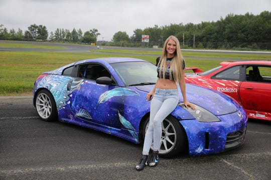 "Alex Biese, Asbury Park Press features reporter, interviews (pictured) Brittany Williams, a ""Hyperdrive"" contestant on Netflix, as he participates in a driving experience with a stunt driver during press day for the new Netflix stunt car racing show, ""Hyperdrive,"" at Old Bridge Township Raceway Park in Englishtown, NJ Tuesday, August 6, 2019."